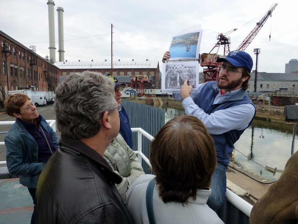 Andrew, tour guide, explaining the workings of a drydock